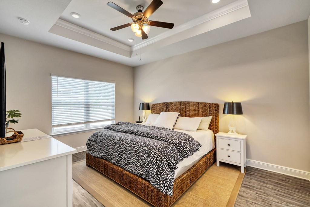 Beautiful tray ceiling decorate the master suite