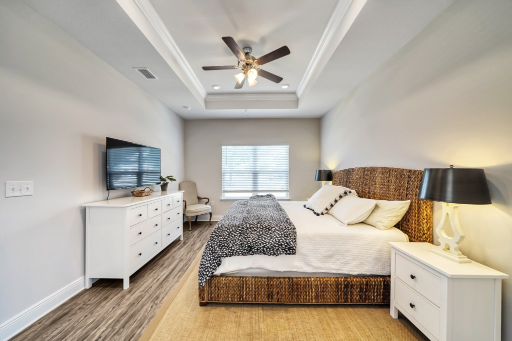 Private king master bedroom with ceiling fan and flat screen, Roku, television