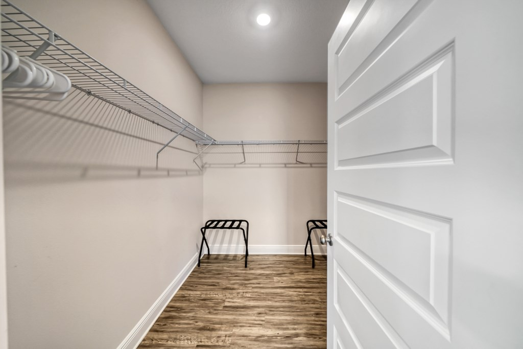 Large walk-in closet with plenty of space for those pesky suitcases