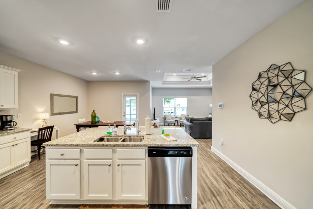 Open living runs throughout the kitchen, dining, and living areas