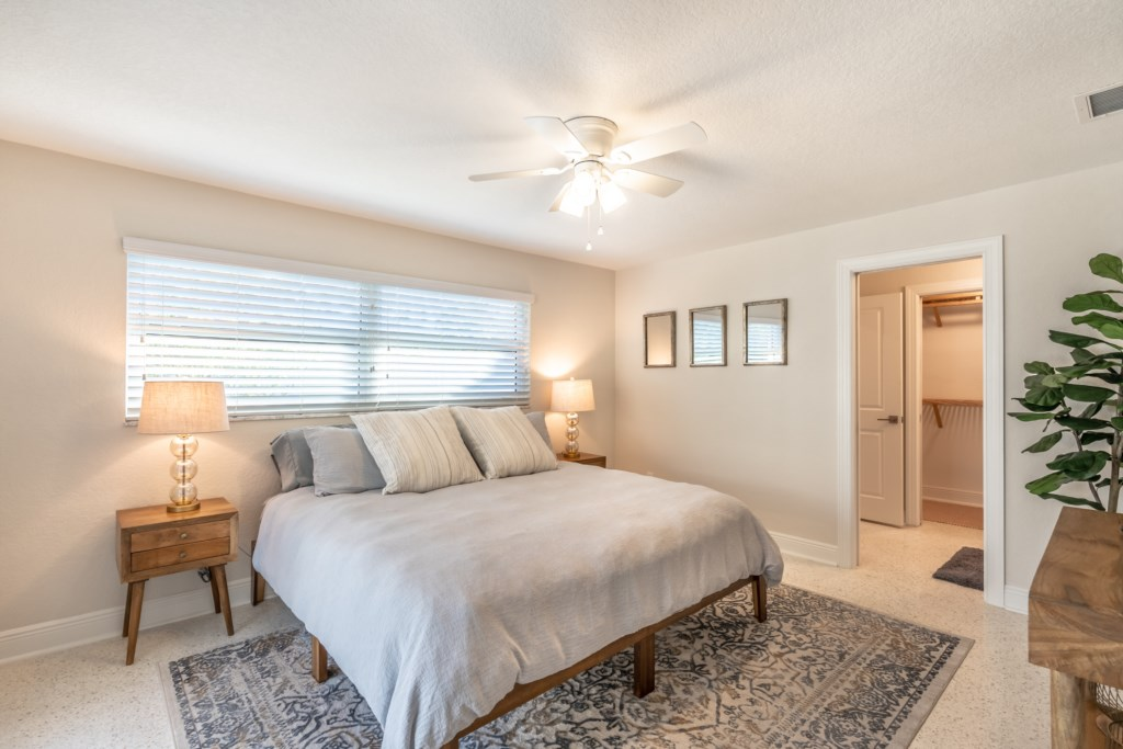 Airy master bedroom with king bed