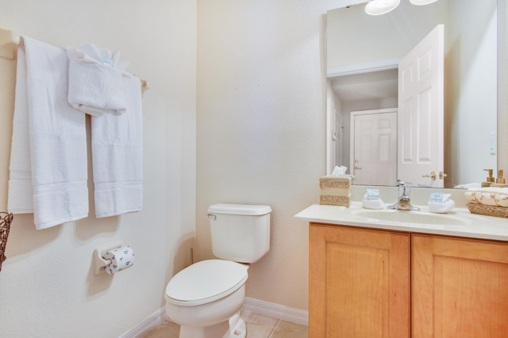 Bathroom 6 - Half bath featuring sink and toilet