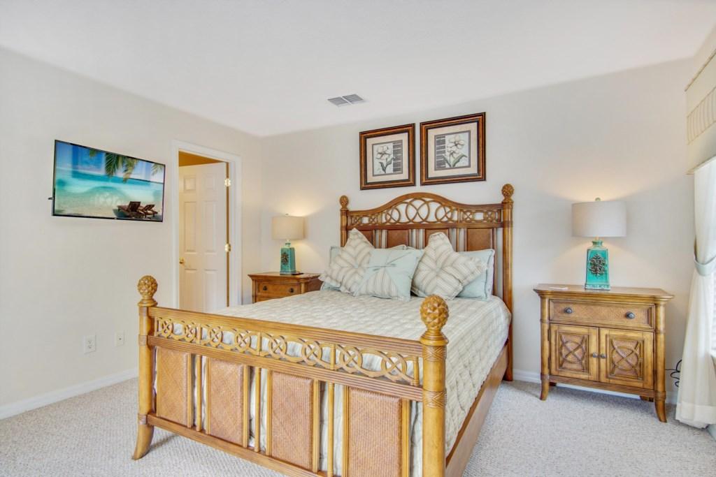 """Bedroom 5- Queen Bedroom (Green Bedspread), 40"""" Private TV, En Suite Bath with Walk In Shower."""