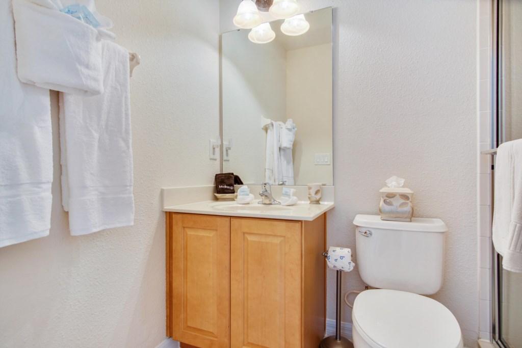 Bathroom 5 - En Suite to Bedroom 5: Single Sink, Toilet, Walk In Shower