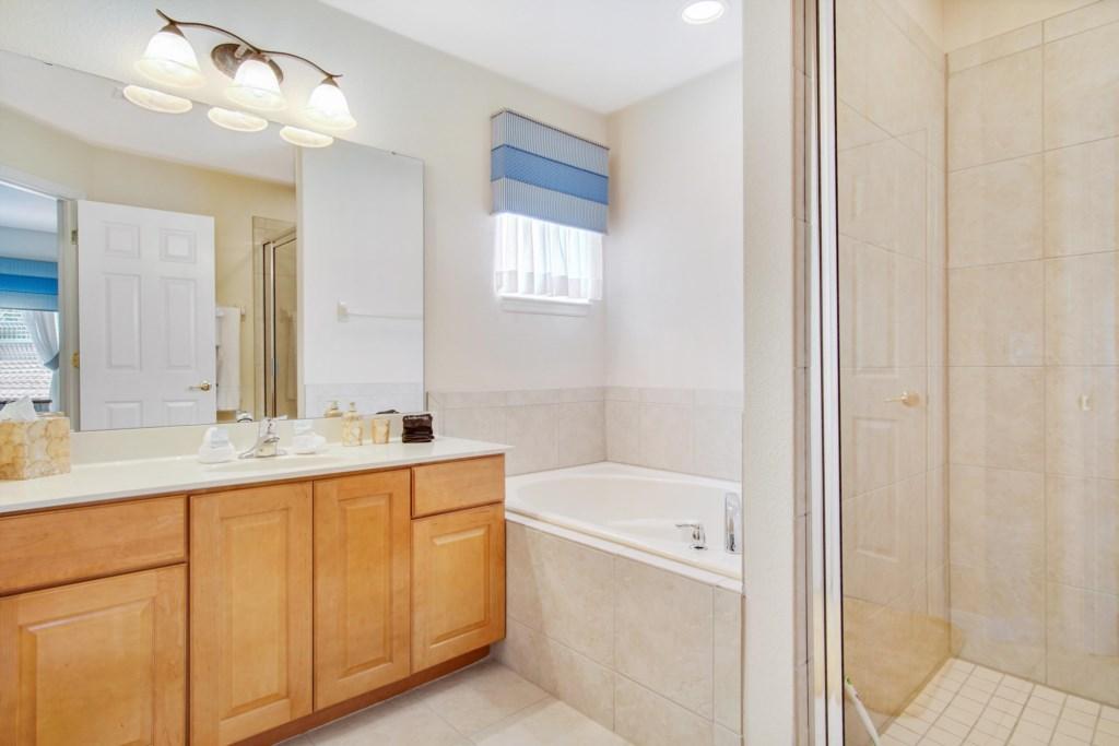 Bathroom 4 - En Suite to Bedroom 4: Single Sink, Toilet Room, Garden Tub, Walk In Shower
