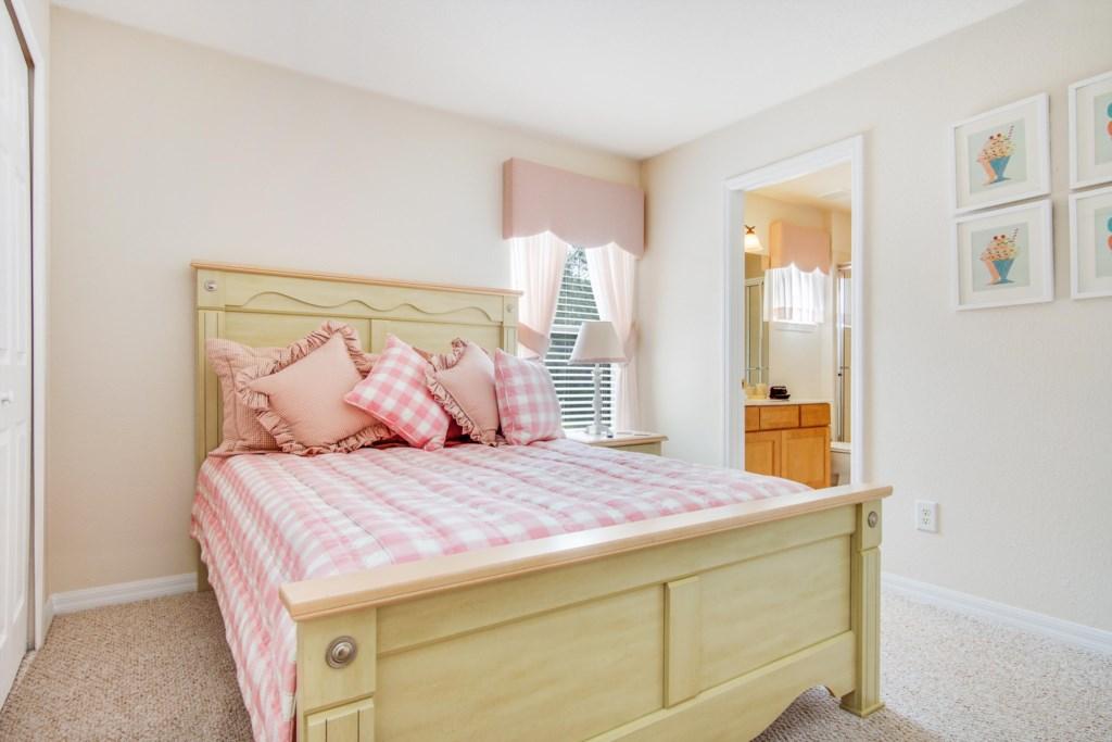 """Bedroom 3 - Queen Bedroom (Pink Bedspread), 40"""" Private TV, En Suite Bath with Walk In Shower"""