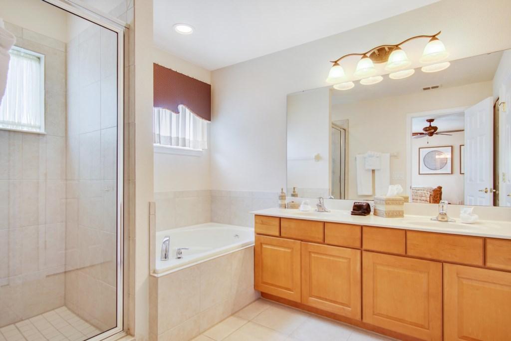 Bathroom 1 - En Suite to Bedroom 1: Walk In Shower, Garden Tub, Double Sinks, Toilet Room