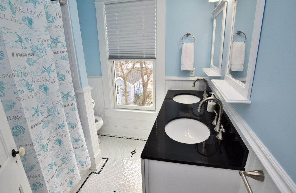 Second floor Full Bath with double vanity and combination tub/shower.