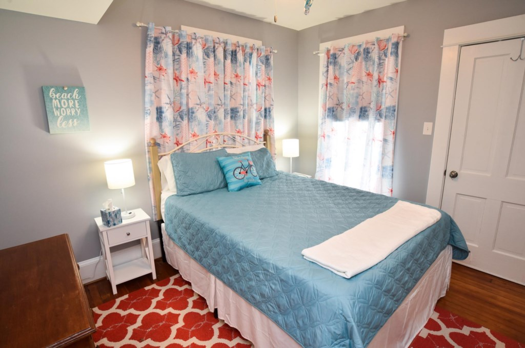 Queen Bedroom with access to a side balcony.