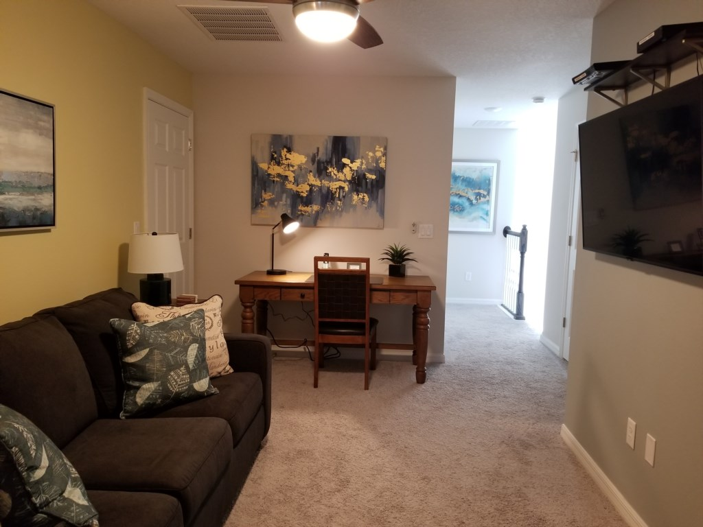 Loft with Large mounted TV, DVD player, desk work area