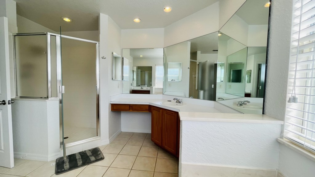 Upstairs Master Bathroom with dual sinks and Garden Tub