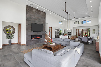 Living Room with fireplace and large flat screen tv with Sonos speakers