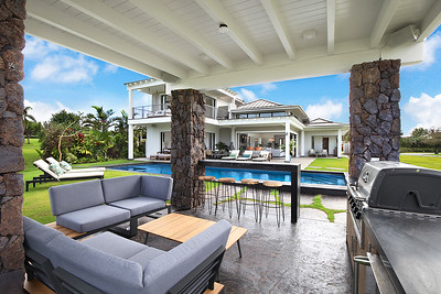 Entertain in the covered grill and bar area overlooking the golf course and ocean views
