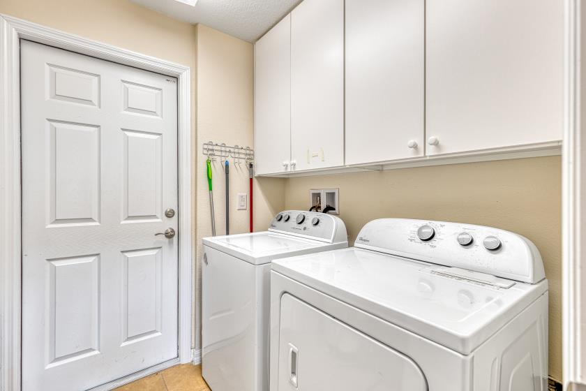There is a full size washer and dryer (2 dryer balls), iron and ironing board, and plenty of pool towels.