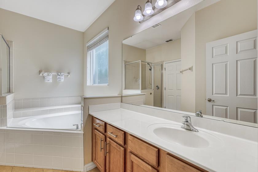 Bathroom 1 - En Suite to Bedroom 1: Walk In Shower, Garden Tub, Toilet Room