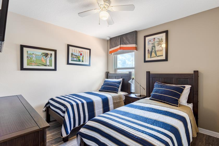 """Bedroom 4 - Twin Bedroom (navy/gold) featuring Two Twin Beds, Private 32"""" TV"""