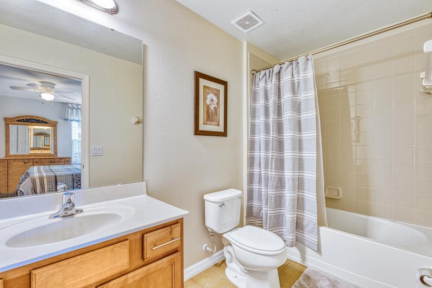 Bathroom 2 - En Suite to Bedroom 2: Shower/Tub Combo, Single Sink