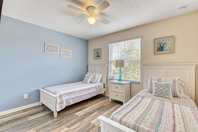 """Bedroom 6 - Twin Bedroom (purple/blue) featuring Two Twin Beds, Private 32"""" TV"""