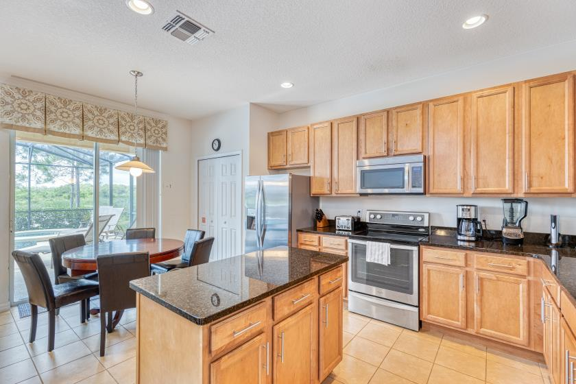 The kitchen is fully stocked with all of the tools and appliances you may need for a quick snack or a gourmet meal!