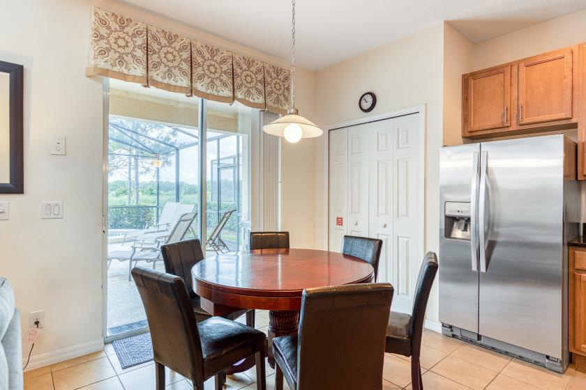As you move into the kitchen, you'll find additional seating for 6 at the round dinette.