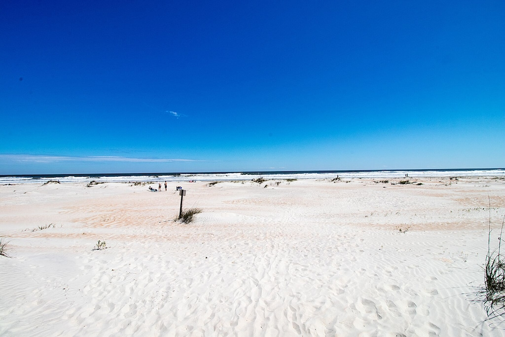 White wide fine sand beaches within steps of the front door