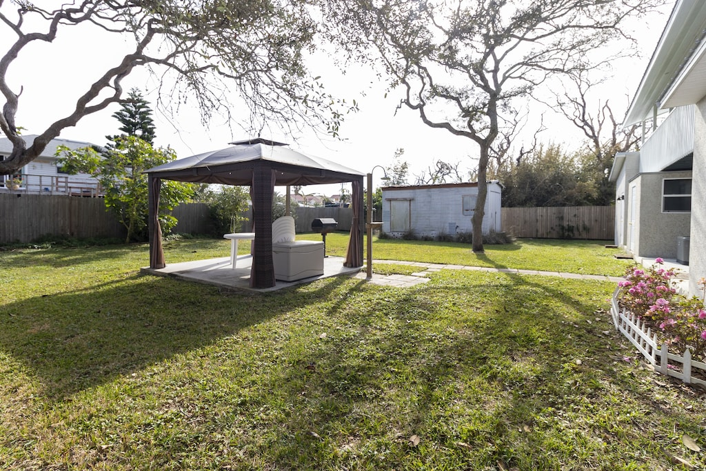 Fenced yard with grill and gazebo