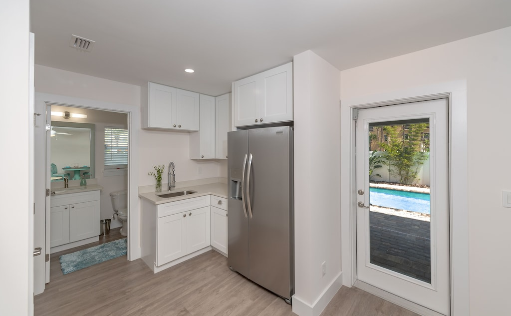 Bottom floor has in law suite with kitchenette and full bath