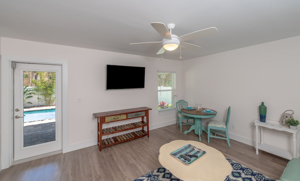 Smart TV in downstairs living room with kitchenette
