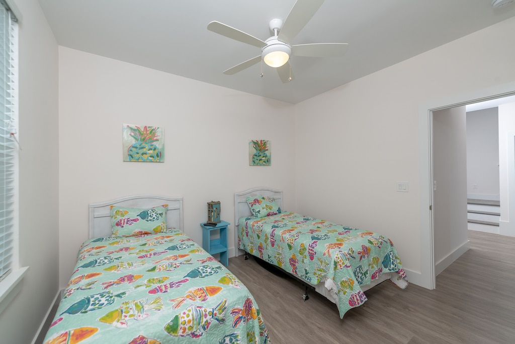 Guest Bedroom 1 with two twin beds and flatscreen tv