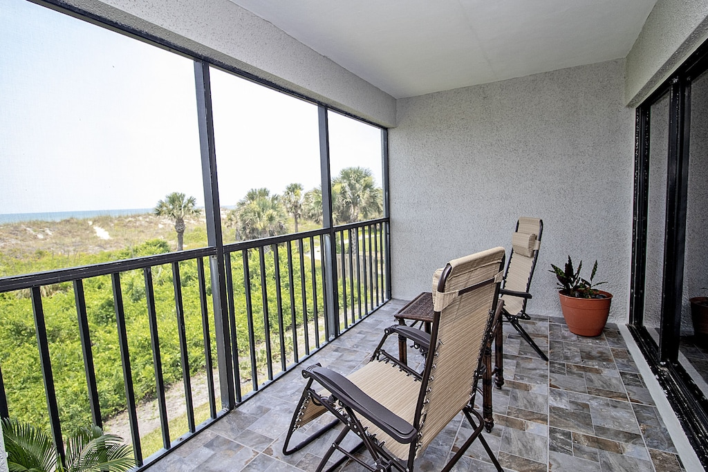 Sit back and relax on our screened porch