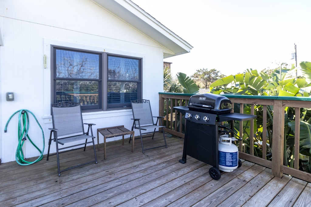 Balcony with seating and grill