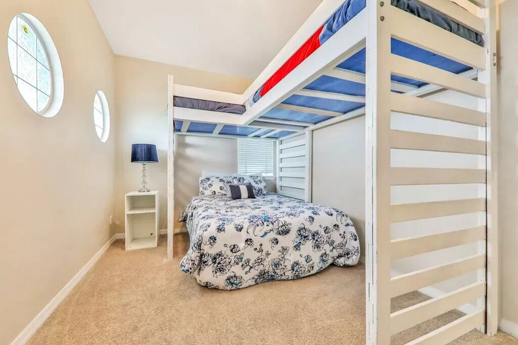 Guest bedroom 2 has a full size bed plus to loft style bunks