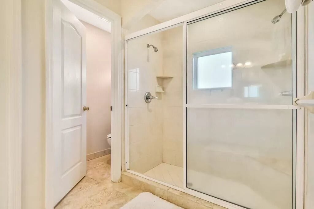 Step in shower with dual showerheads