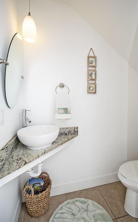 half bath is located downstairs on main floor