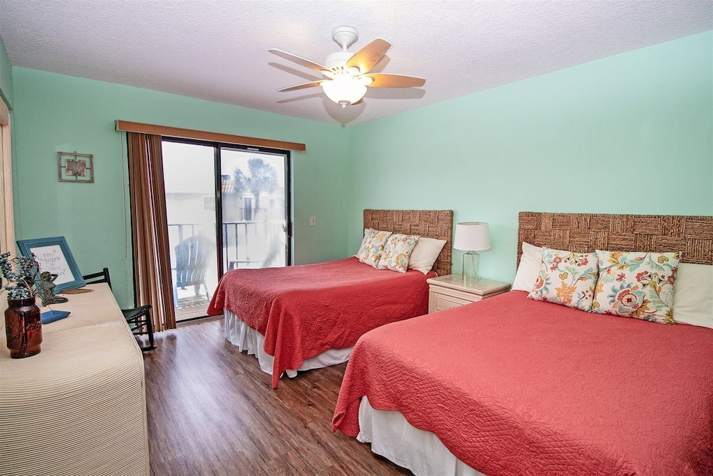 guest bedroom with balcony access