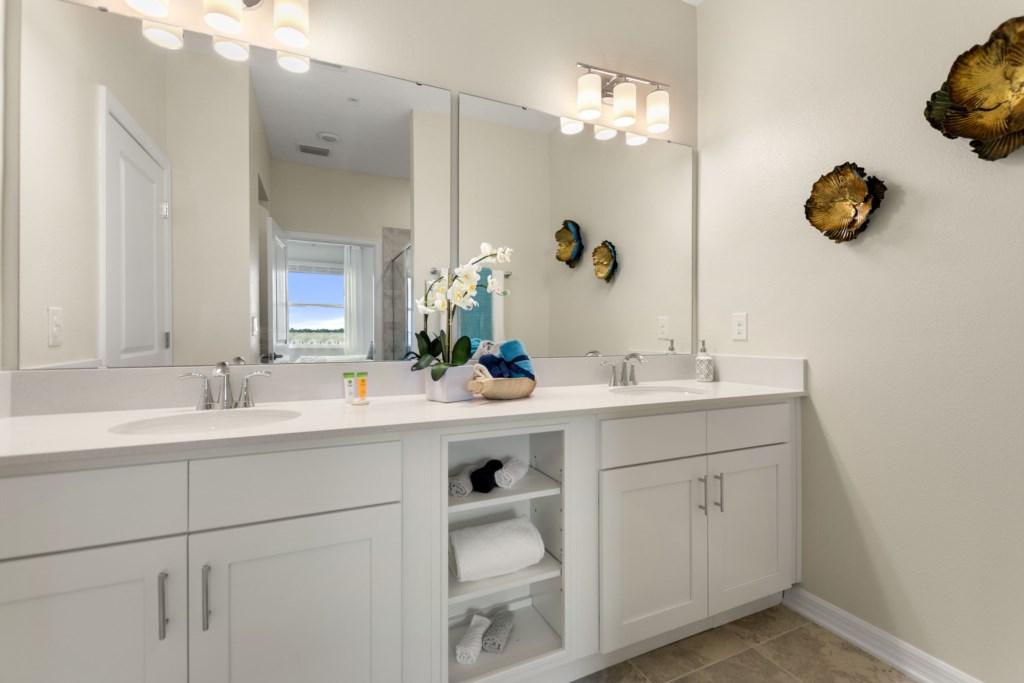Bathroom with wide mirror