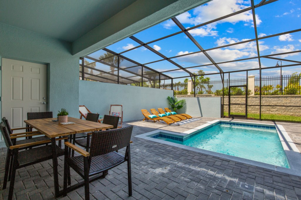 View 3 of Luxurious Private Pool and Spa with Loungers and Patio Seating