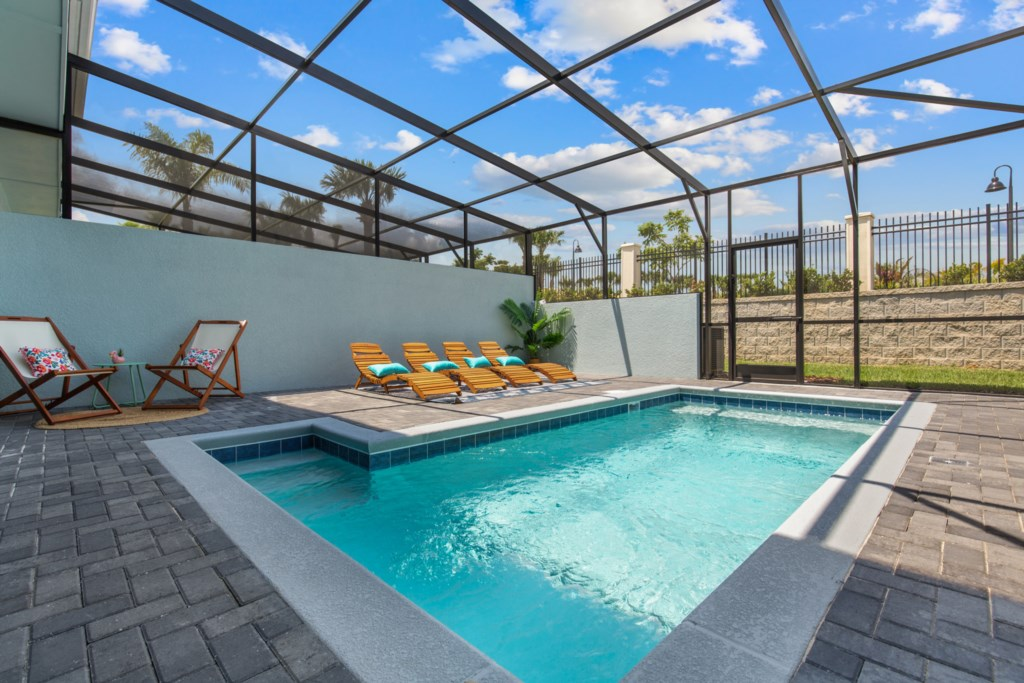View 4 of Luxurious Private Pool and Spa with Loungers and Patio Seating