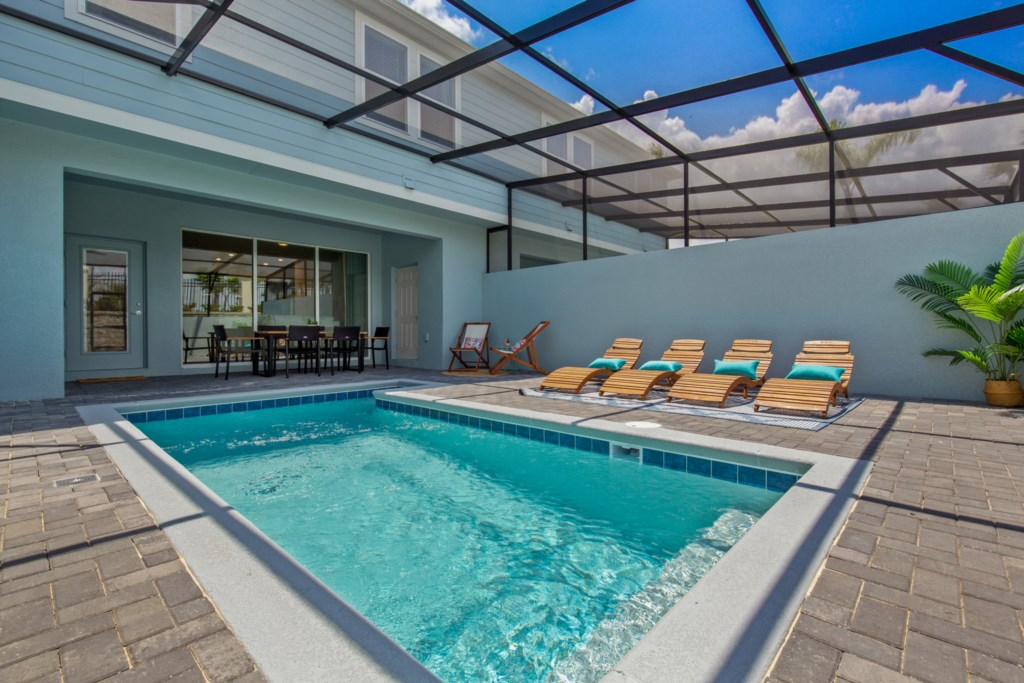 Luxurious Private Pool and Spa with Loungers and Patio Seating