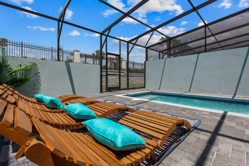 View 2 of Luxurious Private Pool and Spa with Loungers and Patio Seating