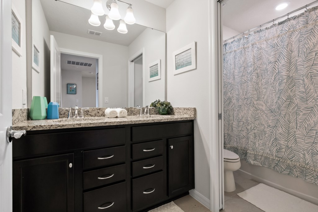 Classic Double Vanity Bathroom with Toilet and Shower/Tub