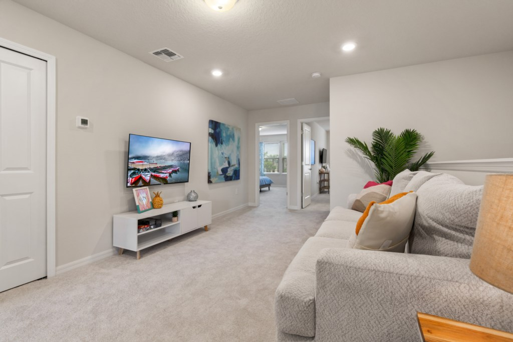 View 2 of Stunning Upstairs Living Area with Flat Screen TV