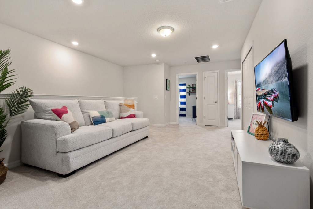 Stunning Upstairs Living Area with Flat Screen TV
