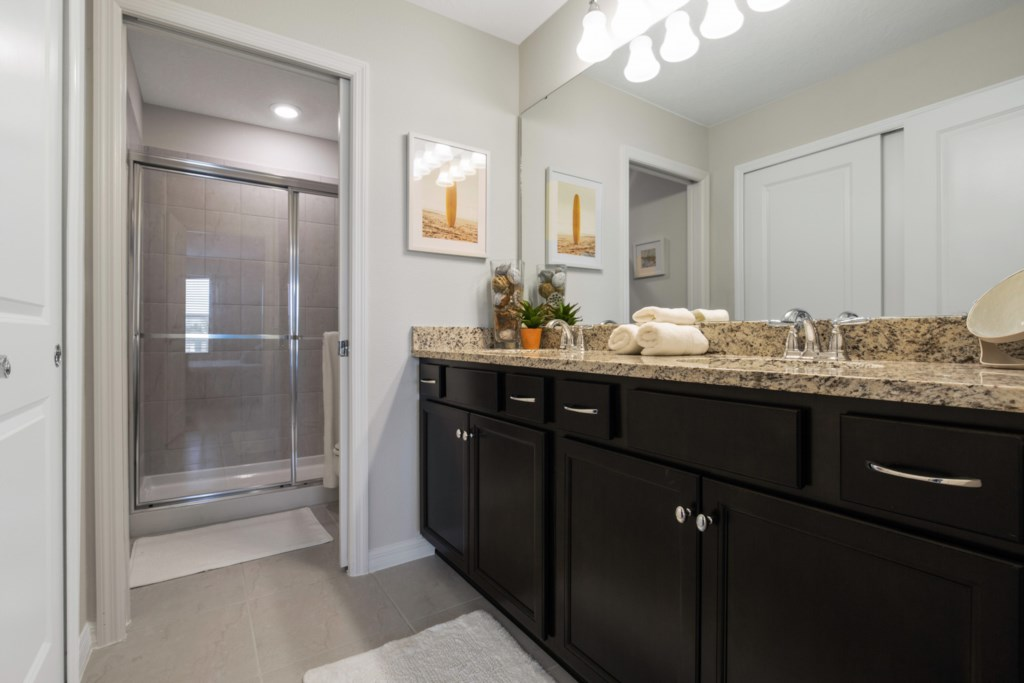 Classy Double Vanity Bathroom with Toilet and Shower