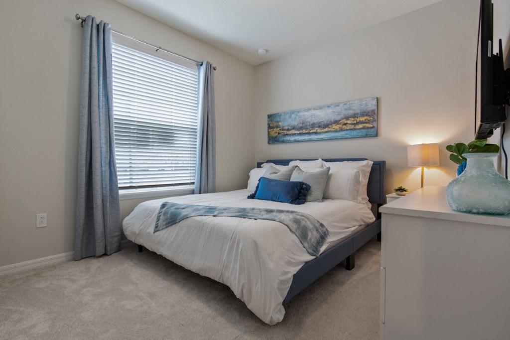 Relaxing King Bedroom with Flatscreen TV