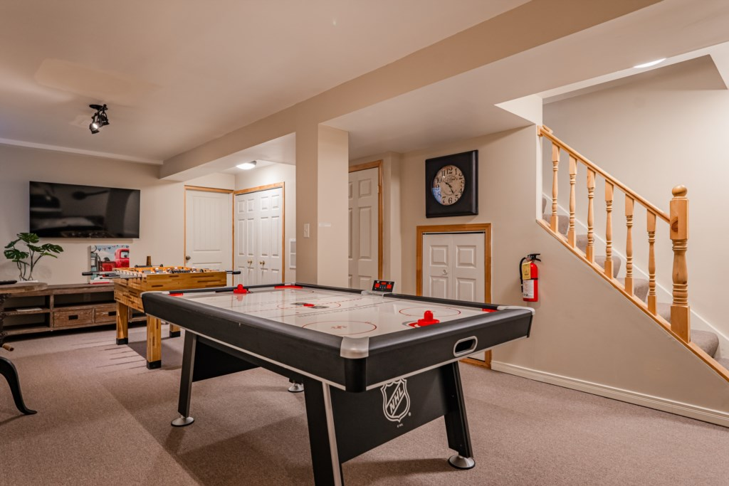 Games room with air hockey table, foosball table and TV - Summerhill House - Niagara-on-the-Lake