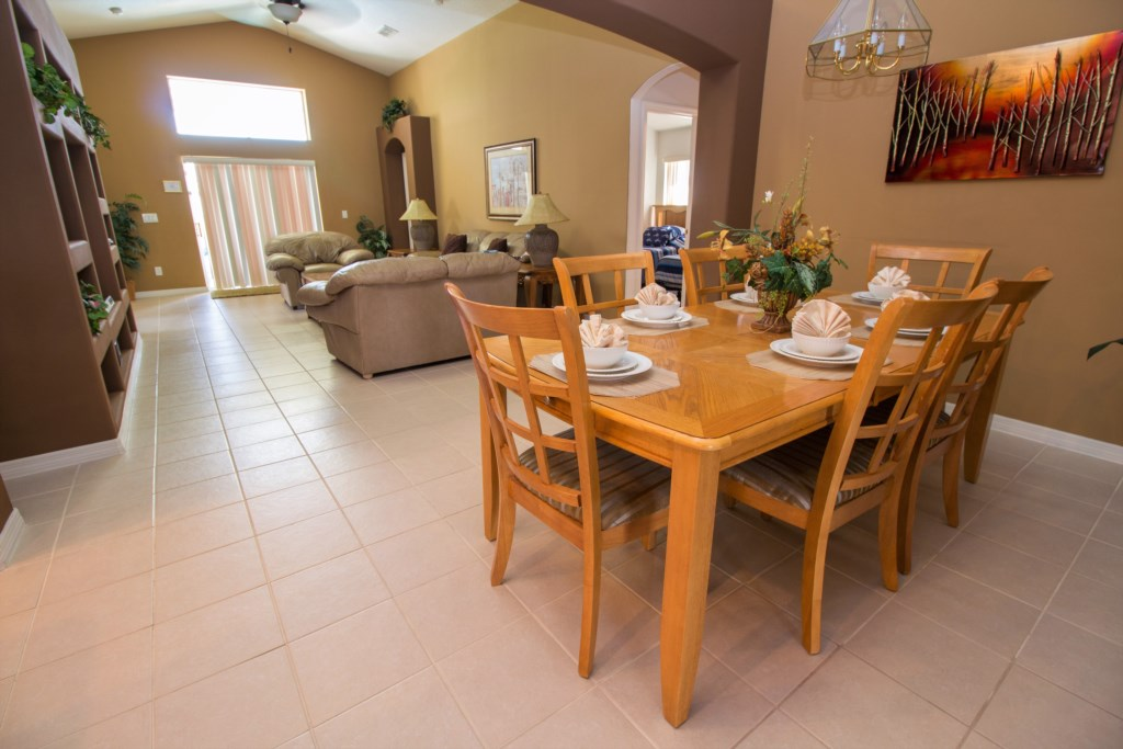 11-The dining room has seating for six in the open plan single level home.jpg