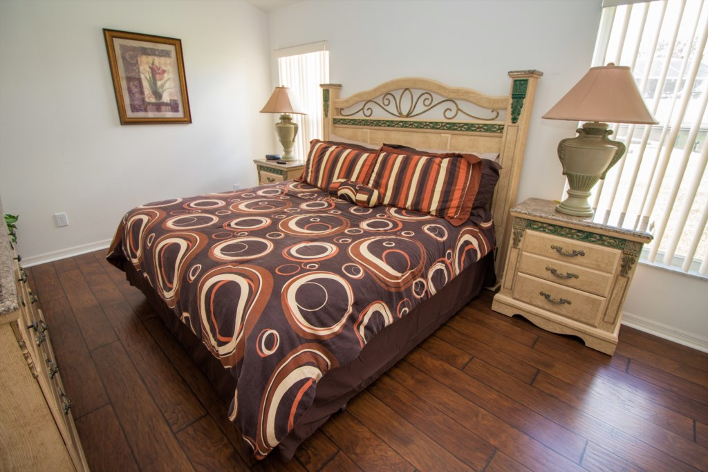 13-The master suite has a king bed and ensuite bathroom.jpg