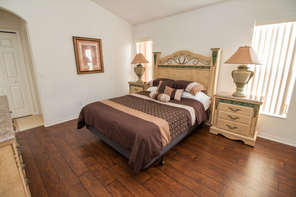 19-This home has a second queen bedroom with an ensuite and pool access.jpg