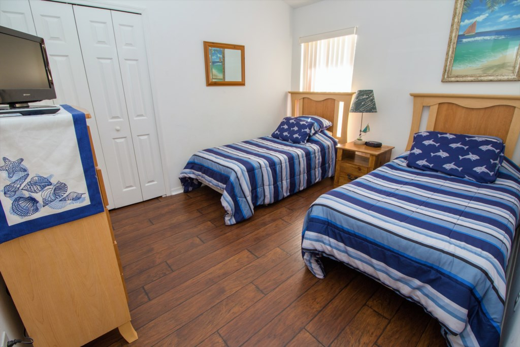 22-Bedroom four has an ocean theme and two twin beds.jpg